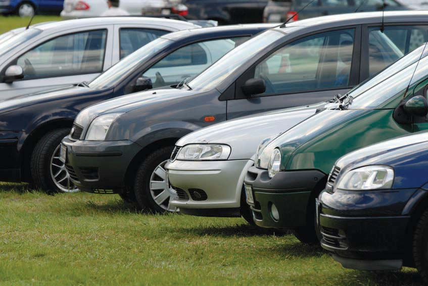 Cars parked on the meadow